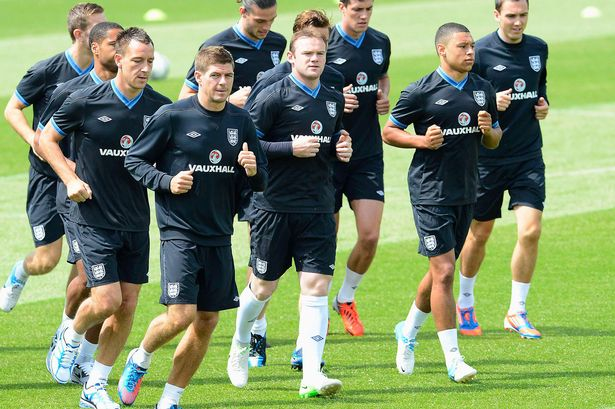 England's national soccer players warm up during a training session for their Euro 2012 soccer match against France-870595